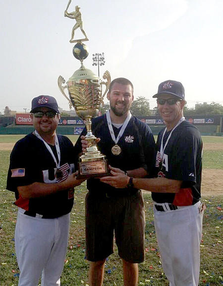 Coaches Matt LaCour, left, and Tom Meusborn pose with the COPABE Pan American Games trphy after the USA 15U team won the tournament.