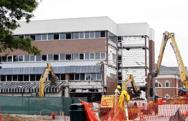 Demolition begins on the administration building on the campus of Christopher Newport University.