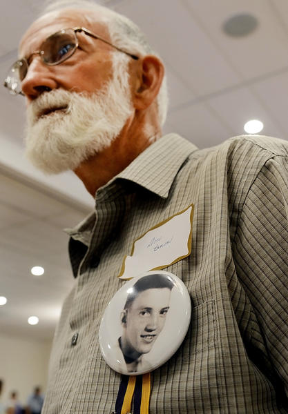 Smithsburg High School Class of 1951 graduate, Don Brown, wore a pin with his senior portrait on it at a class reunion for Smithsburg graduates.