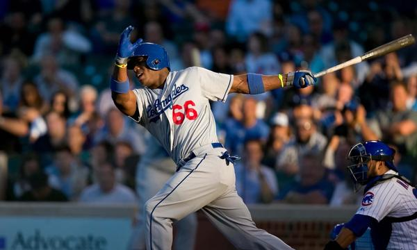 Dodgers right fielder Yasiel Puig injured his left thumb while making a diving catch in Saturday's win over the Chicago Cubs.