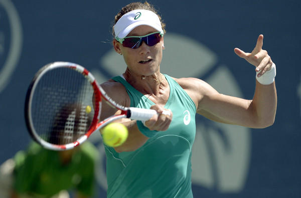 Samantha Stosur of Australia returns a shot against Victoria Azarenka of Belarus during the final of the Southern California Open on Sunday in Carlsbad.