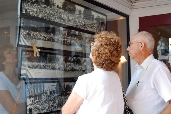 Melvin and Dolores Van Orman look at past Old Home Week photos in Greencastle, Pa., on Sunday. The Van Ormans live in Duncansville, Pa., but enjoy visiting Greencastle, where Dolores previously lived and continues to have family.