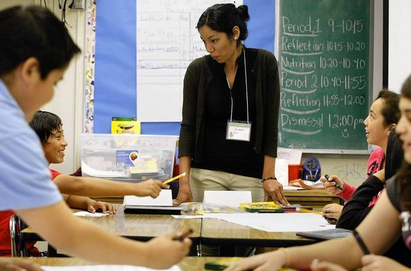Teacher-in-training Robin Sehler instructs seventh-grade science students at Gage Middle School in Huntington Park.