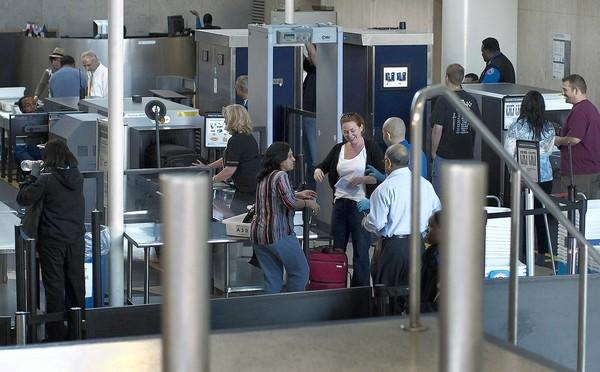 A 26% jump in misconduct cases among TSA workers over a three-year period stoked debate over their integrity. Above, security screening at Los Angeles International Airport in 2011.