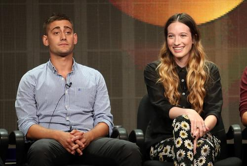"""Actors Michael Socha and Sophie Lowe speak onstage during the """"Once Upon a Time in Wonderland"""" panel."""