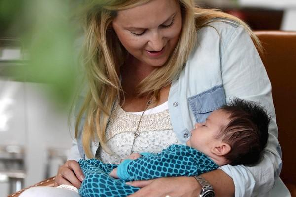 Sandra Spath, 40, holds her 1-month-old son, Kyle, in their Santa Monica home. A demanding career in the fashion industry led her to push off marriage and motherhood. But she's very happy with being an older mom - and it's not so unusual in Santa Monica.