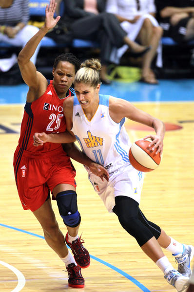 Sky forward Elena Delle Donne tries to drive around Mystic forward Monique Currie.