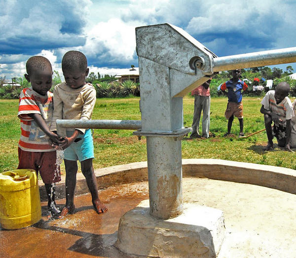 Youth in Kenya gather around a well and enjoy clean, fresh water. Access to quality water is limited in rural African communities. Statistics estimate nearly 1 billion people do not have access to quality water. Organizations such as The Water Project aim to reduce that number by installing wells, rain catchment systems and spring protection systems all aimed at providing a clean source of water for rural communities.