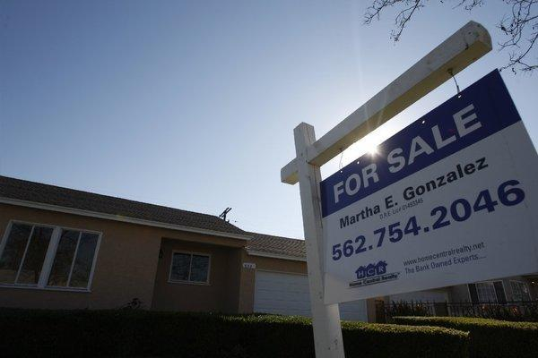 A Compton home for sale earlier this year. While prices didn't increase in the Southern California housing market in July, sales soared.