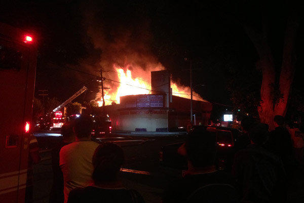 A fire burns in a large commercial market building in the 3300 block of North Verdugo Boulevard in Eagle Rock.