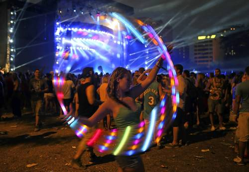 Samantha Liges of Chicago twirls a hula hoop at Perry's Stage in the final hours of Lollapalooza in Chicago on Sunday.