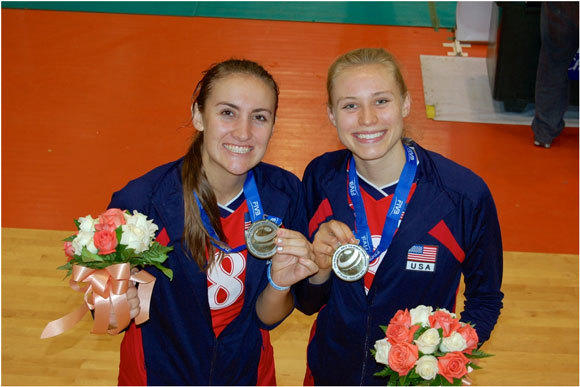 Tia Scambray, left, and Hayley Hodson pose with their medals.