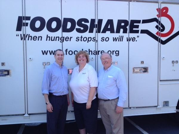 State Rep. Brian Becker, left, with Foodshare President Gloria McAdam, center, and State Rep. Tim LeGeyt, at right, during a recent Mobile Foodshare event in Avon.