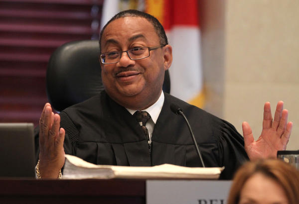 Judge Belvin Perry jokes with jurors during the Casey Anthony trial. Judge Perry was describing how arrangements had been made for the sequestered jury to watch the NHL playoffs that night.