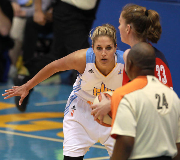 Sky forward Elena Delle Donne guards the Mystics' Emma Meesseman.