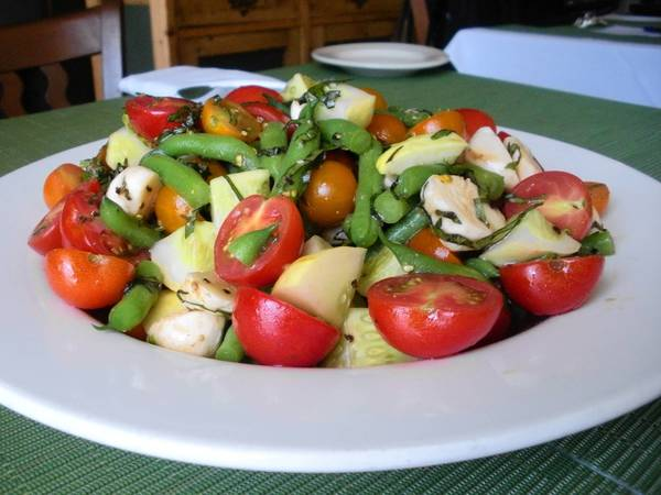 A tomato, vegetable and mozzarella salad makes the best of this season's flavors.