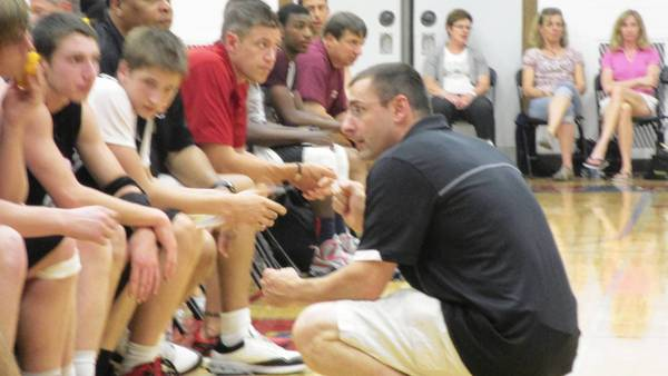 Batavia's second-year coach Jim Nazos talks to his team during summer league play.