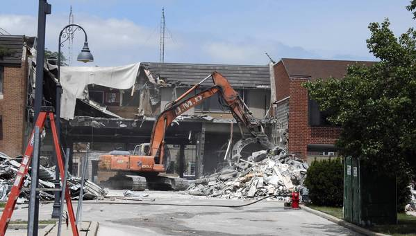 Workers start demolition at 1815 Glenview Road to make way for a future four-story building in downtown Glenview.