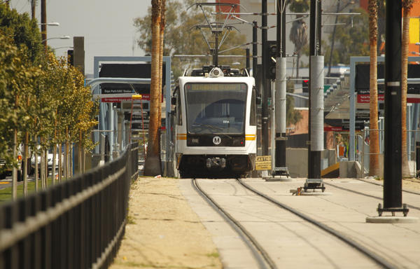 Metro staff test a train on the first phase of the Expo Line near Exposition Park and the USC campus.