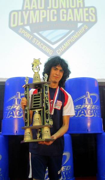 "Wilmette teenager Josh Corwin posed with the trophy Team Illinois recently won at the AAU Junior Olympic Games' ""Sport Stacking Challenge"" in Detroit."
