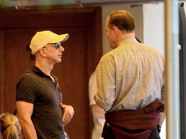 Amazon CEO Jeff Bezos, left, talks with Donald Graham, chairman and CEO of Washington Post Co., at the Allen and Co. Media and Technology Conference in Sun Valley, Idaho, last month.