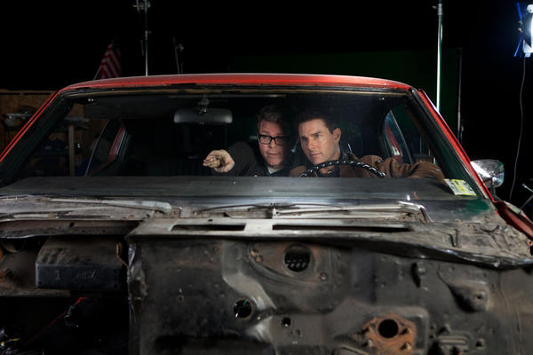 "Director and screenwriter Christopher McQuarrie and Tom Cruise, seen on the set of the 2012 movie ""Jack Reacher,"" will team on the next ""Mission: Impossible."" McQuarrie will direct the star, with Drew Pearce writing the screenplay."