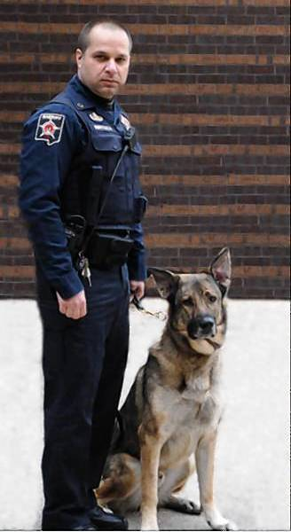Stitch, DuPage County's 9-year-old police dog, died Friday. He worked with Deputy John Bertuca.