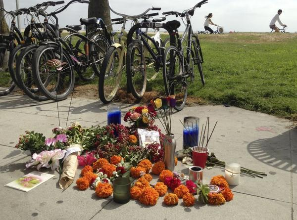 A makeshift memorial along the Venice boardwalk is seen Sunday near where a hit-and-run on Saturday struck several people, killing one woman.