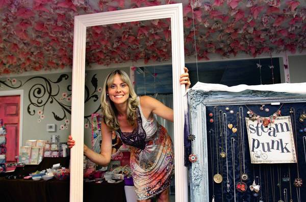 Lynn Wisniewski recently opened Under the Cherry Blossoms boutique in Mount Dora. The shop features handmade designs by about 60 local artists, monogrammed and personalized gifts.