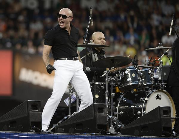 Pitbull, shown performing during baseball All-Star game activities in New York in July, was a popular ticket for California state officials seeking free entrance to concerts.