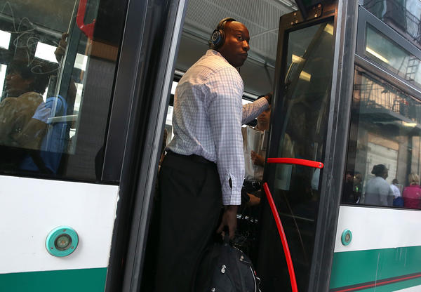 A commuter stands inside an Alameda-Contra Costa (AC) Transit bus in Oakland. Transit workers are threatening to strike starting at 12:01 a.m. Wednesday.