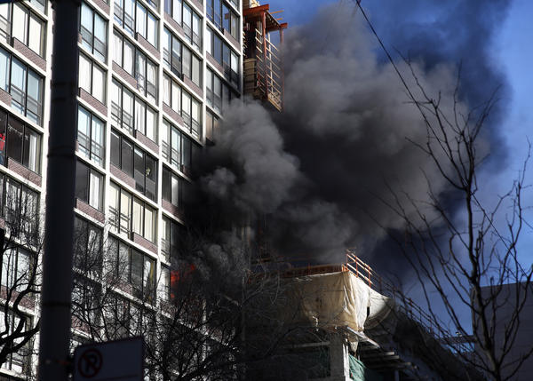 A fire burns in a Near North high-rise this morning.