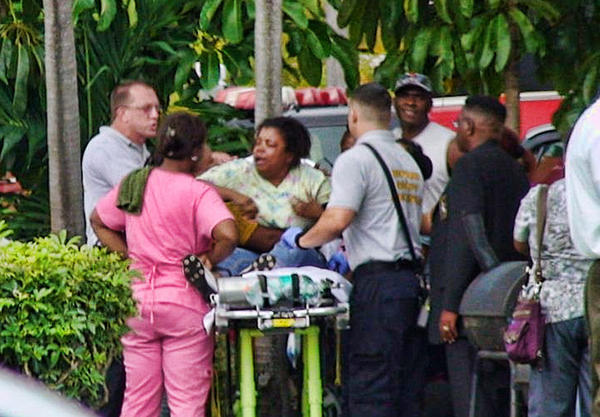 A distraught woman, identified as the mother of the victim, was taken to the hospital.