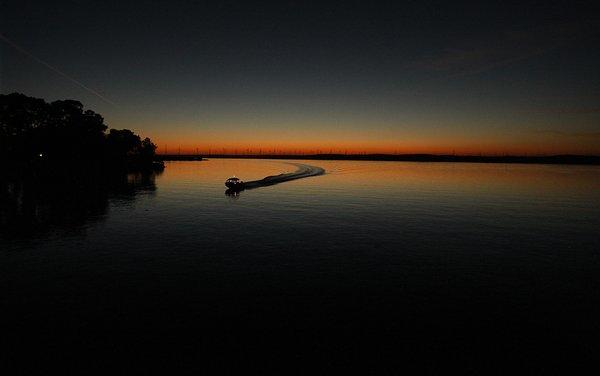 A boater heads for home port as the sun sets on the Sacramento-San Joaquin delta near the town of Rio Vista.