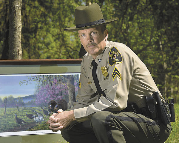 Cpl. Scott Forrest of the Maryland Natural Resources Police recently was named Conservation Officer of the Year by the Maryland chapter of the National Wild Turkey Federation. The Foundation presented him a print of turkeys in the wild.