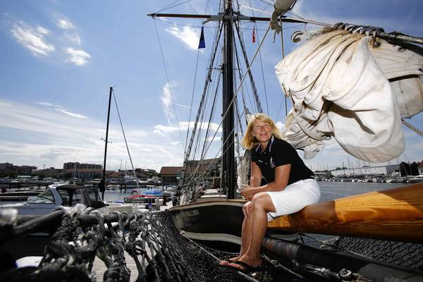 Dawn Parker Santamaria sits aboard the Navy Pier-bound Unicorn -- the only all-female crewed tall ship in the world -- as it lies docked in Racine, Wis., on Sunday.
