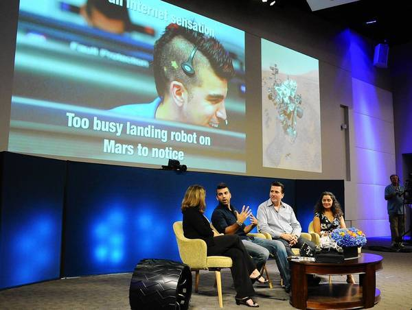 "Bobak ""Mohawk Man"" Ferdowsi and other members of the Mars rover Curiosity team participate in a pannel discussion."