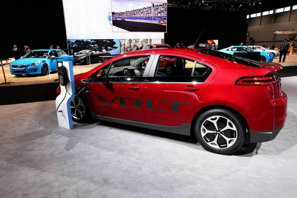 The sticker price isn't changing on 2012 and 2013 Volts, but GM has already offered $5,000 rebates on those cars, along with discounted lease deals. Above, a 2013 Volt at the Chicago Auto Show.