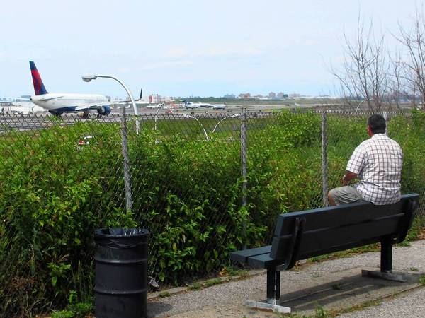 Plane spotter Douglas Thompson watches jets from the aptly named Planeview Park outside LaGuardia Airport in New York.