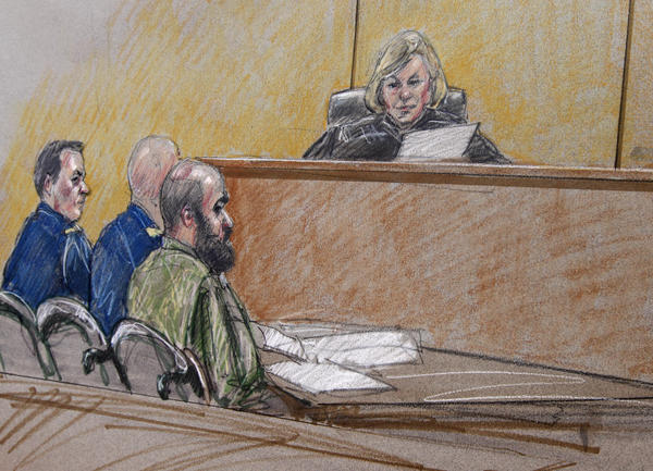 In a courtroom sketch of a pretrial hearing, Maj. Nidal Hasan, right, sits by his former defense attorneys, Maj. Joseph Marcee, far left, and Lt. Col. Kris Poppe, center, with the judge in the case, Col. Tara Osborn, behind the bench,