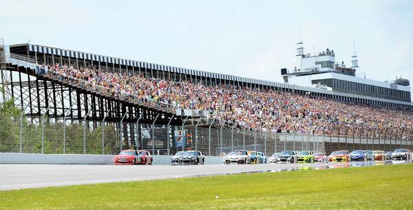 The field passes the grandstand at The Party in the Poconos 400 NASCAR race at Pocono Raceway in Long Pond in June.