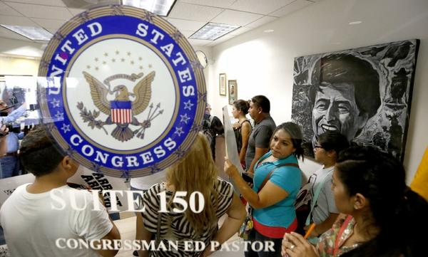 "Protesters seek a meeting with the staff of Rep. Ed Pastor (D-Ariz.) about the ""Dream 9"" in July."