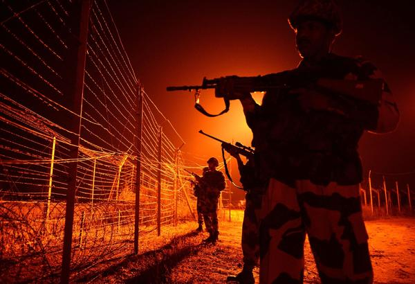 Indian Border Security Force soldiers go on patrol at an outpost along the India-Pakistan border.