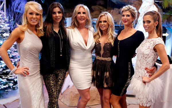 The housewives at Vicki's Winter Wonderland party, pre-drama.