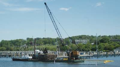 Dredging work is seen at Petoskey's marina in 2011. Additional dredging work is expected this year.