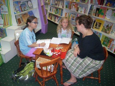 Olivia Cerrudo and Annie Bergmann (from left) interview Jessilynn Norcross as part of the Spartan Writing Camp North.