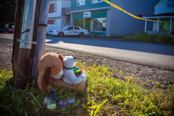 A memorial sits outside the Reptile Ocean exotic pet store in Campbellton, New Brunswick. Two boys are believed to have been killed by a python in an apartment above the store.