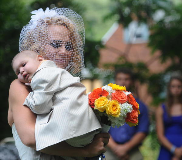 Christine Swidorsky carries her son and the couple's best man, Logan Stevenson, 2, down the aisle to her husband-to-be Sean Stevenson during the wedding ceremony in Jeannette, Pa. Christine Swidorsky Stevenson says on her Facebook page that Logan died in her arms at 8:18 p.m. Monday, Aug. 5, 2013, at their home in Jeannette, about 25 miles east of Pittsburgh.