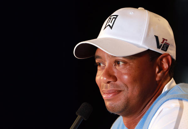 Tiger Woods meets the media after a practice round for the 95th PGA Championship at Oak Hill Country Club.