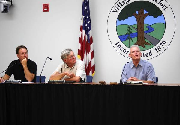 Frankfort Mayor Jim Holland, right, looks up toward a video monitor during the Aug. 5 meeting of the Frankfort Village Board. Next to him are Trustee Todd Morgan, left, and Trustee Dick Trevarthan.